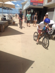 Family riding at Merewether Beach
